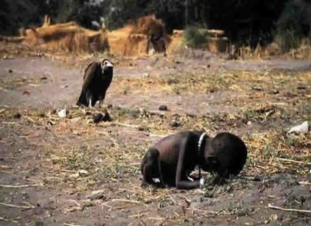 A Sudanese child crawls 1km to a hunger camp. The vulture waits eagerly for the child to die.