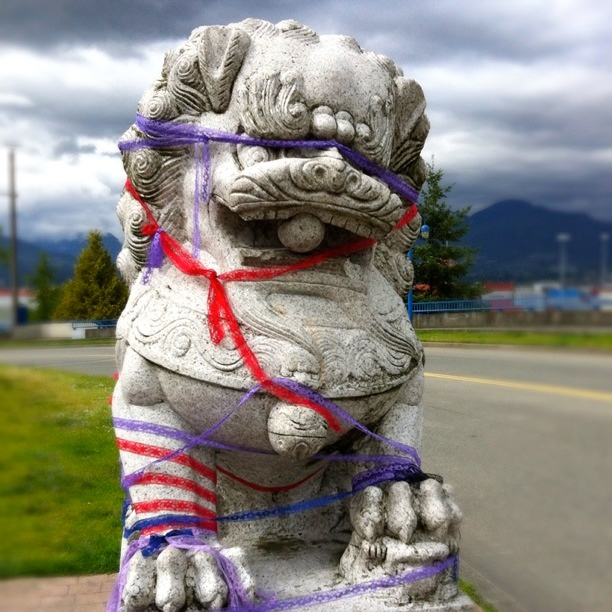 Grey Stone Lion Wrapped With Sexy Ribbon Gastown
